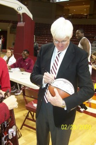 Coach Cremins signing basketballs after the game!